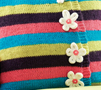 Multi-coloured striped flower cushion