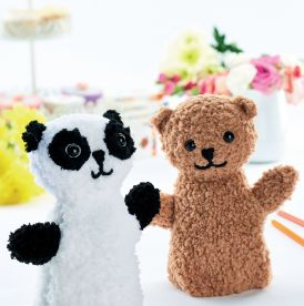 Teddy bear and panda puppets
